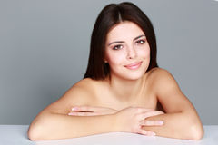 Beauty portrait of a young female model. On gray background Royalty Free Stock Photo