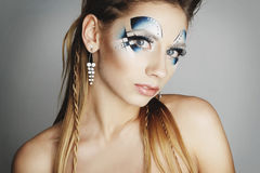 Beauty portrait of a young girl with bright blue makeup. Art bea Stock Photo