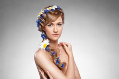 Beauty portrait of young girl with flowers in hair. Beauty portrait of young girl with blue and white flowers in hair Stock Image