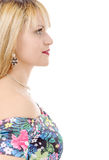 Beauty portrait of young  girl in profile with blond hair. on wh Royalty Free Stock Image