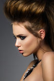 Beauty portrait of young glamorous woman with fashion hairdo Stock Photos