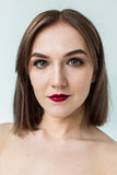 Beauty portrait of young model with middle length hair. Professional nude makeup Royalty Free Stock Photography