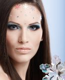 Beauty portrait of young model. In professional makeup with rhinestones Stock Photos