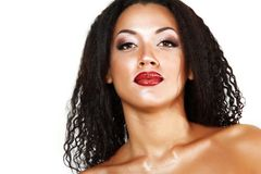 Beauty portrait of young mulatto fresh woman with beautiful make. Beauty portrait of young mulatto fresh fashion woman with beautiful makeup over white Stock Images