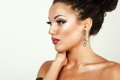 Beauty portrait of young mulatto fresh woman with beautiful make. Up in profile Stock Photography