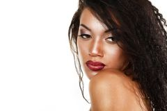 Beauty portrait of young mulatto fresh woman with beautiful make. Up in profile over white background Stock Images