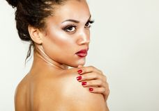 Beauty portrait of young mulatto fresh woman with beautiful make. Up.  on white background Royalty Free Stock Images