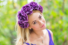 Beauty portrait of young pretty girl with flower Royalty Free Stock Image