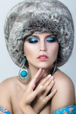 Beauty portrait of young pretty lady wearing fur cap Stock Image
