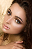 Beauty portrait of young pretty woman with fashion make-up Stock Photography