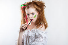 Beauty portrait of a young red-haired girl with creative hairstyle and makeup Stock Image