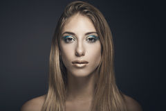 Beauty portrait of young sexy woman. Against blue background Royalty Free Stock Photos