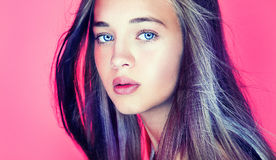 Beauty portrait of young teenage girl. Portrait of beautiful young teenag girl over pink background Royalty Free Stock Photography