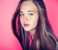 Beauty portrait of young teenage girl. Portrait of beautiful young teenag girl over pink background Stock Photo