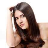 Beauty portrait of young woman with beautiful long brunette hair Stock Photography