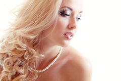Beauty portrait of young woman bride with beautiful makeup and a Stock Photography