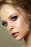 Beauty portrait of young woman with classic makeup. Beauty portrait of young woman with classic make up. Perfect skin and colorful smokey eyes makeup, smokey Stock Image