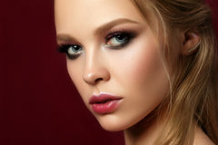 Beauty portrait of young woman with classic makeup Royalty Free Stock Images