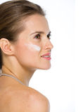 Beauty portrait of young woman with creme on cheek Royalty Free Stock Photo