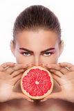 Beauty portrait of young woman with fruit. Stock Images