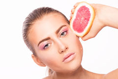Beauty portrait of young woman with fruit. Royalty Free Stock Photography