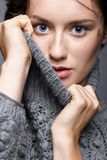 Beauty portrait of young woman in gray wool sweater. Brunette gi Royalty Free Stock Photo