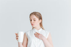 Beauty portrait of a young woman holding cup with tea Royalty Free Stock Images