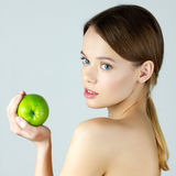 Beauty portrait of young woman holding green apple Stock Photo