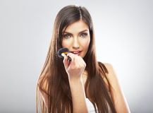 Beauty portrait of young woman holding make up bru Royalty Free Stock Images