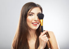 Beauty portrait of young woman holding make up bru Stock Photo