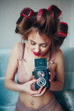 Beauty portrait of young woman holding vintage camera Royalty Free Stock Photography