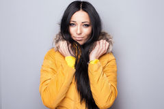 Beauty portrait of young woman with hood. Royalty Free Stock Photo