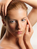 Beauty portrait young woman touching her face stock photos