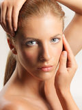 Beauty portrait young woman touching her face stock images
