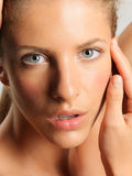Beauty portrait young woman touching her face stock photo