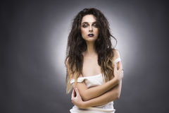 Beauty portrait of the young woman with a vanguard make-up. Beauty portrait of the young woman in a white undershirt with a vanguard make-up and a flowing hair stock photography