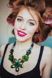 Beauty portrait of young woman wearing curlers Royalty Free Stock Images