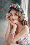 Beauty portrait of young woman with wreath of flowers in hair stock photography