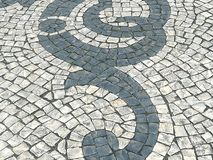 Portuguese Sidewalk. The beauty of the Portuguese sidewalk mozaic Royalty Free Stock Photography
