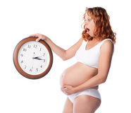 Beauty pregnant woman with clock wait childbirth Stock Photos