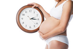 Beauty pregnant woman with clock wait childbirth Stock Images