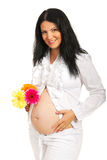 Beauty pregnant woman holding flowers Stock Photos