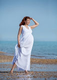 Beauty pregnant woman on sea beach Royalty Free Stock Image