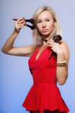 Beauty procedures, woman holds make-up brushes near face. Stock Photos