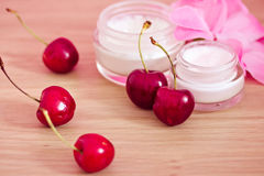 Beauty product with natural ingredients (cherries). Concept of organic cosmetics, lotions and cherries Stock Image