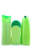 Beauty products. Three different  green beauty and hygiene products. On overwhite background Stock Photos