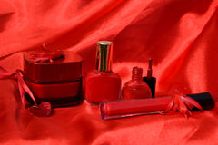 Beauty products. Cosmetics. Red nuances. beauty products in red colors on a red background Stock Photos