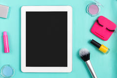 Beauty products, everyday make-up and mobile on blue Royalty Free Stock Image