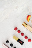 Beauty products, everyday makeup with berries and peach for color comparison. copy space Stock Image