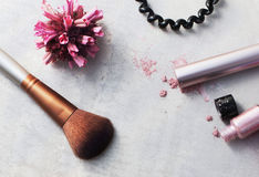 Beauty products, everyday makeup vibrant background, top view. Beauty products, everyday makeup vibrant background. Cosmetic essentials - mascara, eyeshadow Stock Image